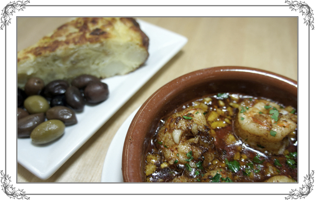 Spanish stew and Greek olives at Spanish restaurant El Meson